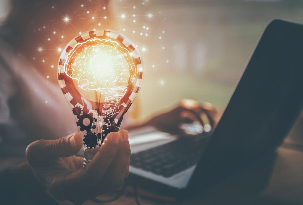 business woman holding lightbulb